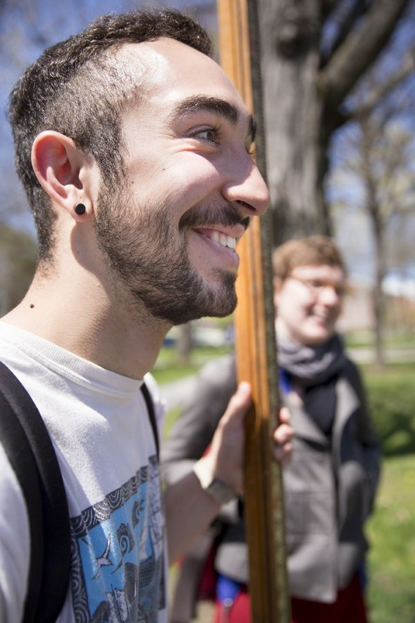 """The whole idea of using these ancient [mapmaking] methods is really interesting to me,"" said Justin Hoden '18, an avid sailor from Bryn Mawr, Pa. Hoden is holding a stadia rod, and Visiting Assistant Professor of History Katherine McDonough is in the background. (Phyllis Graber Jensen/Bates College)"