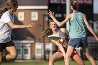 Josie Gillett '19 of Seattle delivers a pass during practice on May 12, 2016. (Josh Kuckens/Bates College)