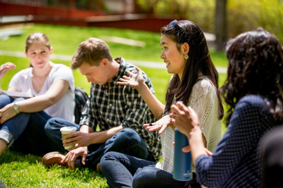 "Megan Tan shares a thought with the ""Life Architecture"" class during a session on the Historic Quad. (Phyllis Graber Jensen/Bates College)"