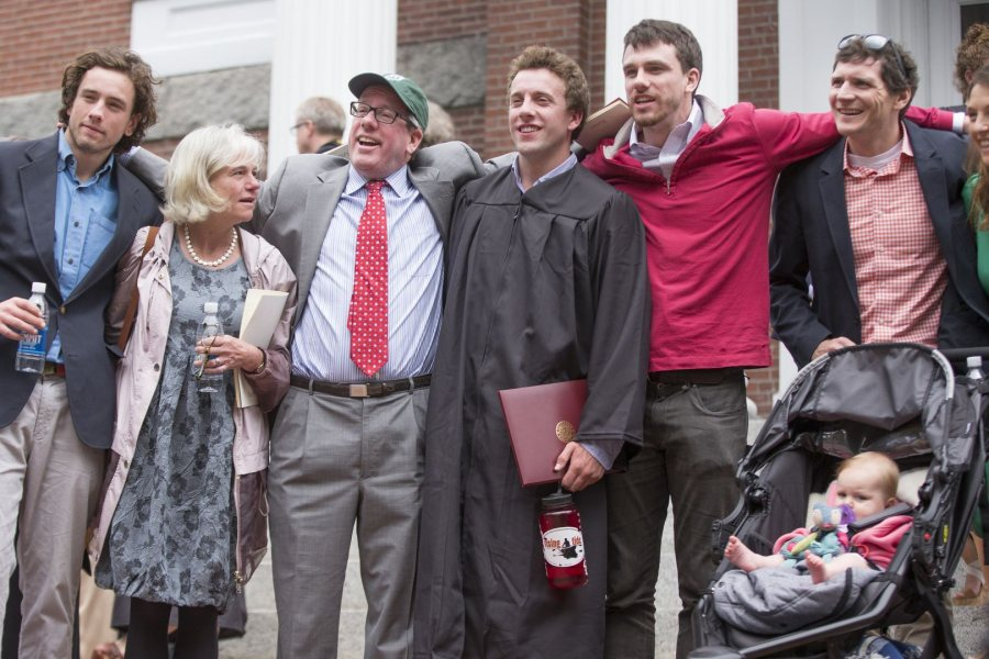 William Cleaves '16 gathers with members of his family, including cousin John McDevitt '04 (far right) and his daughter, Norah, 7 months, for a post-Commencement photograph on the steps of Hathorn Hall. (Phyllis Graber Jensen/Bates College)