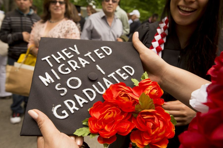 Yessenia Saucedo '16 of Los Angelos holds her mortarboard after the ceremony. (Phyllis Graber Jensen/Bates College)