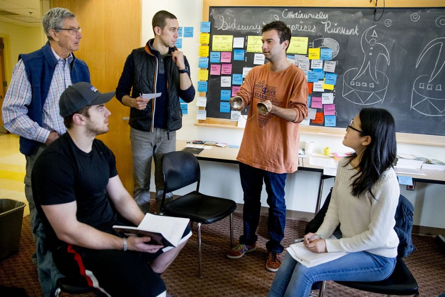 """Yutong Li '18 (right) of Shanghai, China, listens as Fisher Qua leads a discussion during the Short Term practicum """"Consulting for Strategy Development (Phyllis Graber Jensen/Bates College)"""