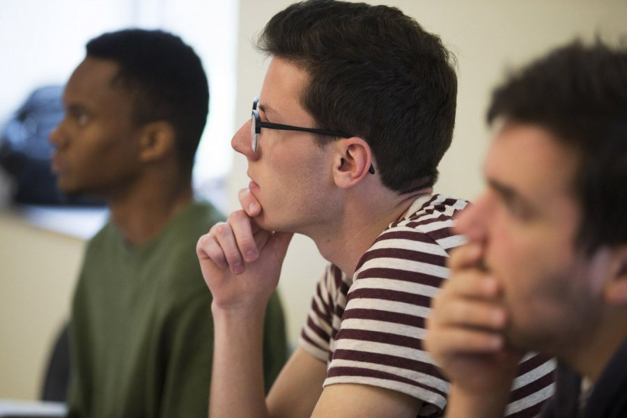 "Ben Palmer '16 of Minneapolis (center) listens during a class session of ""Journalism in an Age of Media Explosion."" (Phyllis Graber Jensen/Bates College)"