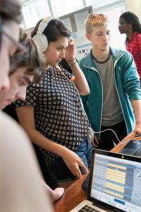 Listening to mixes by students in a music recording and production course taught by Jonathan Wyman '97. (Phyllis Graber Jensen/Bates College)