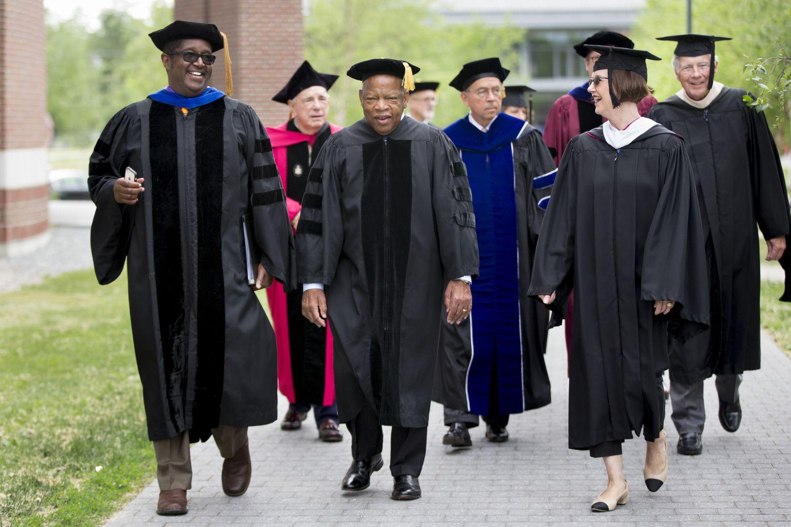 Commencement speaker John R. Lewis, the civil rights icon and congressman from Georgia, processes down Alumni Walk with Professor of Rhetoric Charles Nero and Bates Trustee Geraldine FitzGerald '75. (Phyllis Graber Jensen/Bates College)