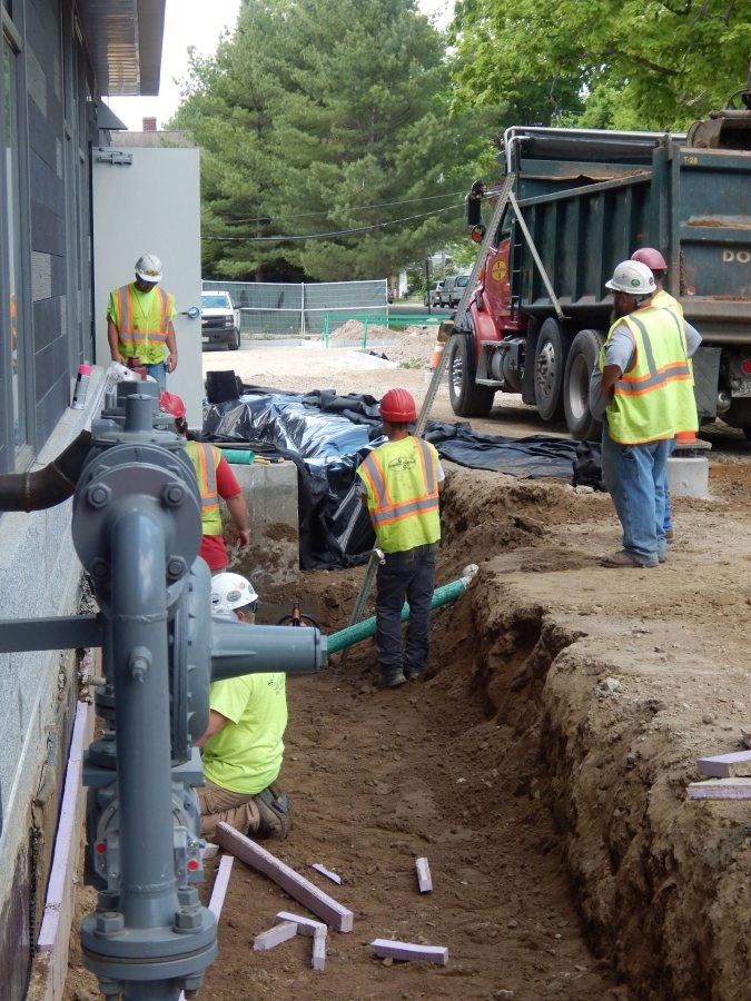 Shown on May 31, 2016, workers for Gendron & Gendron build a feature to divert stormwater runoff at 55 Campus Ave. (Doug Hubley/Bates College)
