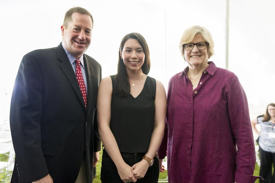 Cat Djang '13, recipient of the David G. Russell Alumni-in-Admission Award at Reunion on June 11, poses with President of the Alumni Association Michael Lieber '92 and President of Bates College Clayton Spencer. (Josh Kuckens/Bates College)