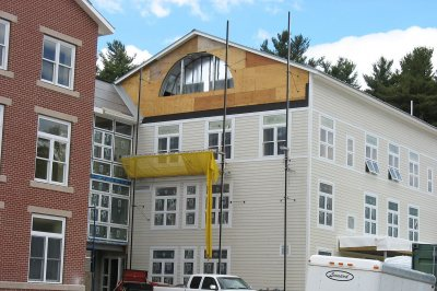 Like louvers do: This semi-circular hole in the center-section gable at 280 College Street will accommodate a ventilation louver. (Doug Hubley/Bates College)