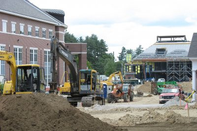 This view eastward, toward the new Commons, depicts a busy morning on Alumni Walk. (Doug Hubley/Bates College)
