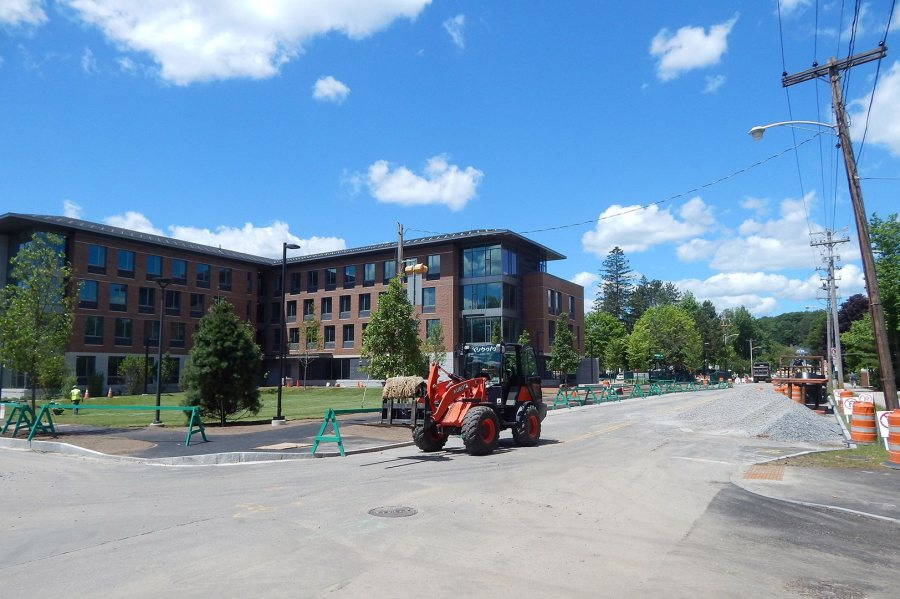 At rear, recent landscaping is evident at 55 Campus Ave. on June 30, 2016. The loader at center is carrying strips of turf. Campus Avenue is closed for sewer replacement. (Doug Hubley/Bates College)