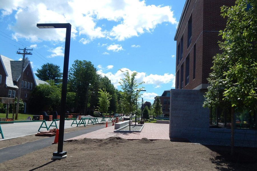 New curbs, plantings, sidewalk, lighting, and brick paving at 55 Campus Ave. on June 30, 2016. (Doug Hubley/Bates College)