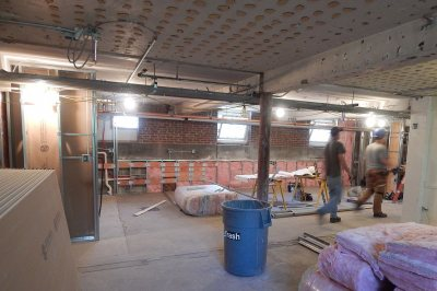 At rear in this photo taken July 5, 2016, a kitchen and banquette will be installed in this recreation area in the basement of Smith Hall. (Doug Hubley/Bates College)