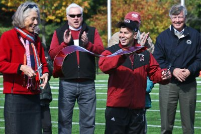 In October 2010, Director of Athletics Kevin McHugh and then-President Elaine Hansen share ribbon-cutting honors to dedicate major donor-funded renovations of Garcelon Field. (Photograph by Janet Ciummei / Northeast Pro Photo)