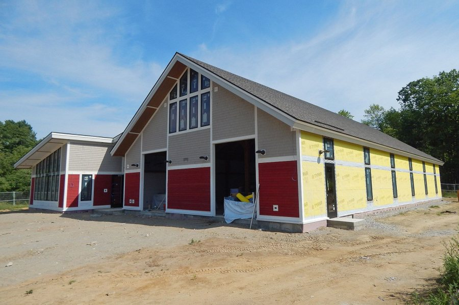 The exterior wall coverings were in place on the front of Bates' new boathouse by late July 2016. (Doug Hubley/Bates College)