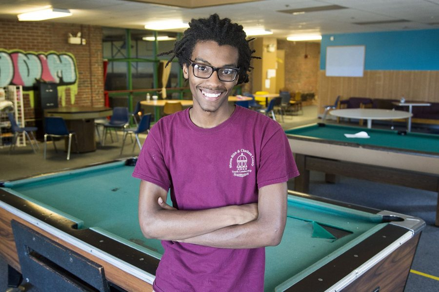 Cristopher Thompson '19 of Macon, Ga., poses for a portrait at the Boys and Girls Club of Auburn, where he worked with young people this summer supported by a fellowship from the Harward Center for Community Partnerships. (Josh Kuckens/Bates College)