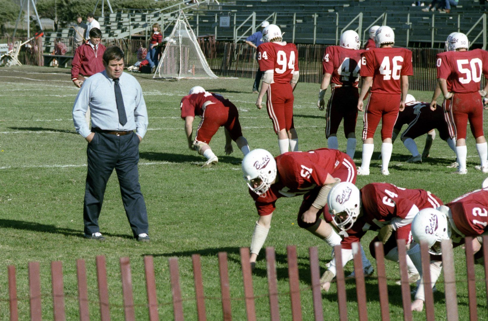 Bob Flynn watches the Bobcat linemen go through warmups in 1981. (Steve Fuller '82 photograph)