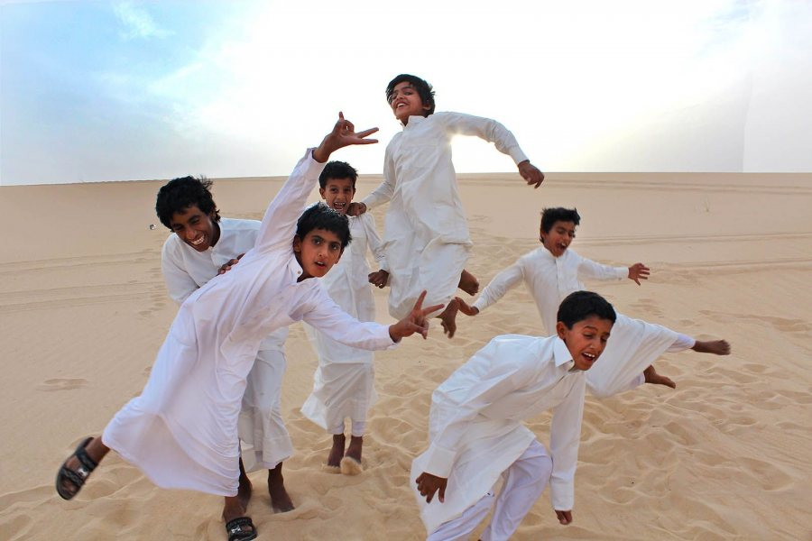 During the 2012 Short Term to Saudi Arabia, a group of Saudi boys cavort for the camera during a desert outing to the Eastern Province. (Photograph by Gintare Balseviciute '13)