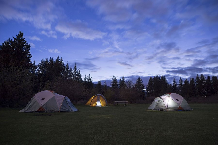 Unplugged from everything except the sky above, students and their professors call it a night at a Madison River campground near Yellowstone National Park on May 17. (Josh Kucken/Bates College).