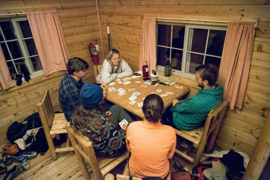 Students play cards in their West Yellowstone campground cabin on May 21 during their Short Term geology trip to the Northern Rockies. (Josh Kuckens/Bates College)