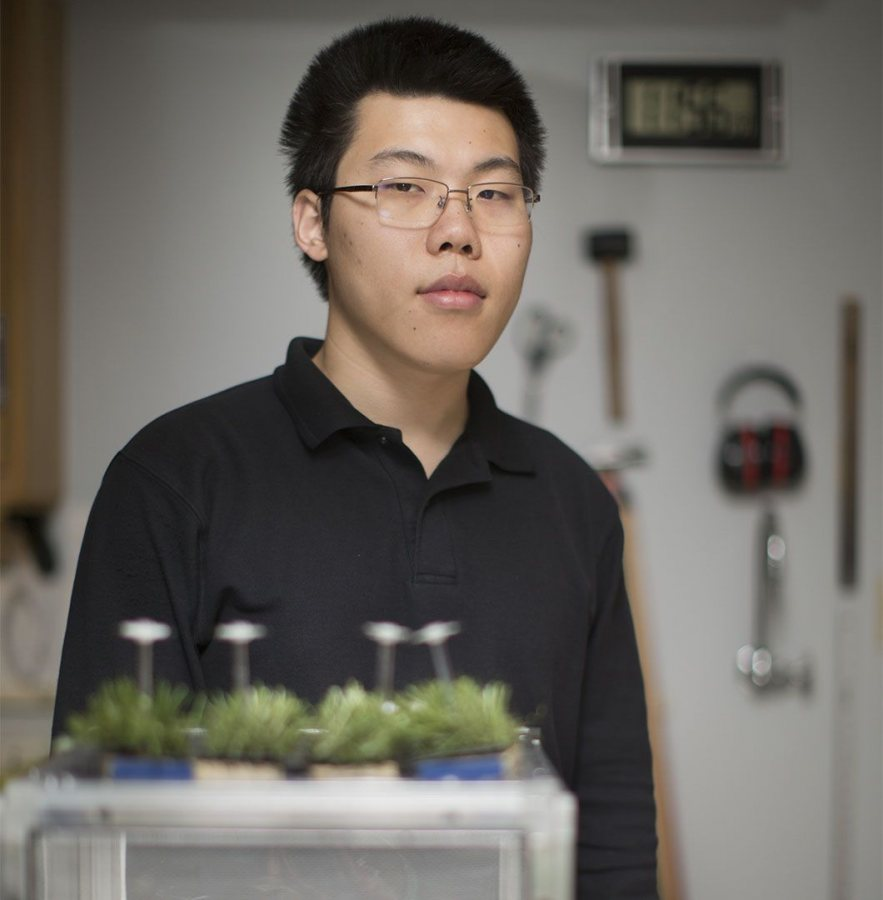 Xioameng Wang '19 poses in the lab of Assistant Professor of Biology Carla Essenberg. (Phyllis Graber Jensen/Bates College)