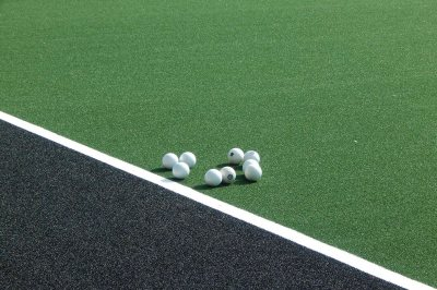 Field hockey balls on the GreenFields TX turf on Sept. 1, 2016, the second day of practice on the new surface. (Doug Hubley/Bates College)