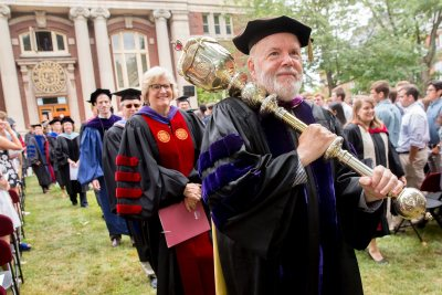 President Clayton Spencer follows as the college mace bearer, Charles Franklin Phillips Professor of Economics Michael Murray, leads the Convocation 2016 Recessional away from Coram Library. (Phyllis Graber Jensen/Bates College)