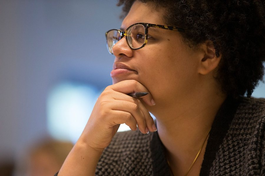 One of eight presenters at Bates' New Approaches to Early Modern Literature and Culture symposium, Patricia Akhimie of Rutgers University of Newark listens to a talk by a fellow presenter in a classroom in Commons on Sept. 26. (Phyllis Graber Jensen/Bates College)