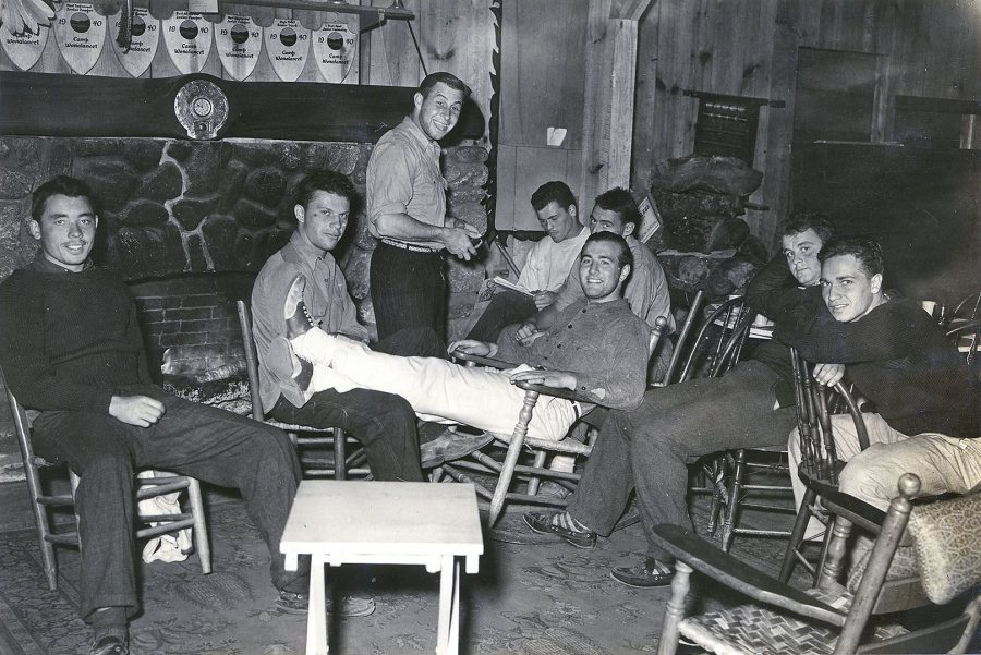 Bates football players relax in the lodge of Camp Wonalancet in Eaton Center, N.H. during their preseason training, circa September 1939. (Photograph by Richard Bowers Oliver)