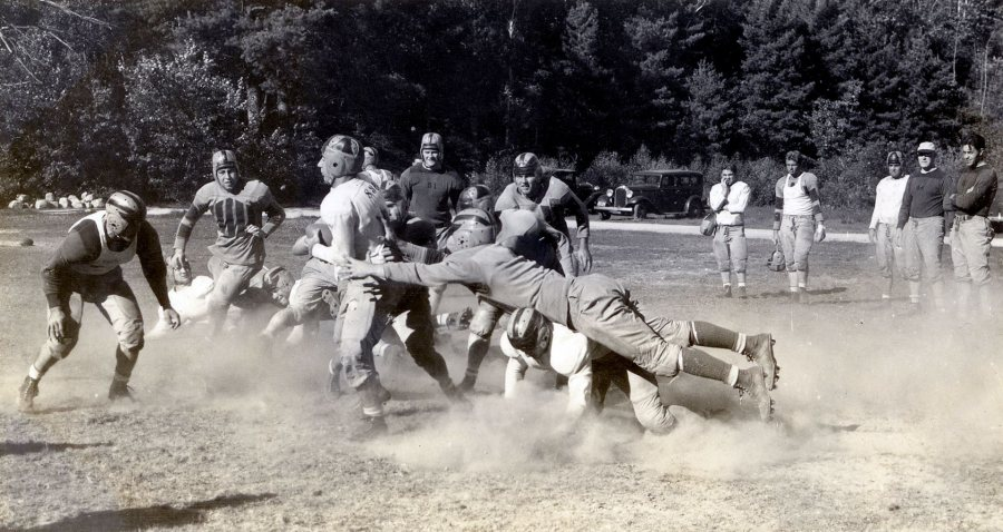 Bates football players do preseason drills at Camp Wonalancet in Eaton Center, N.H. The year is likely 1939. (Photograph by Richard Bowers Oliver)