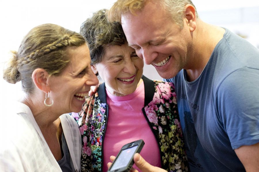 Rachel Segall '91 and Michael Foley '89 embrace Marcy Plavin on May 2, 2015, during rehearsals for the evening's alumni dance concert to honor Plavin. (Phyllis Graber Jensen/Bates College)