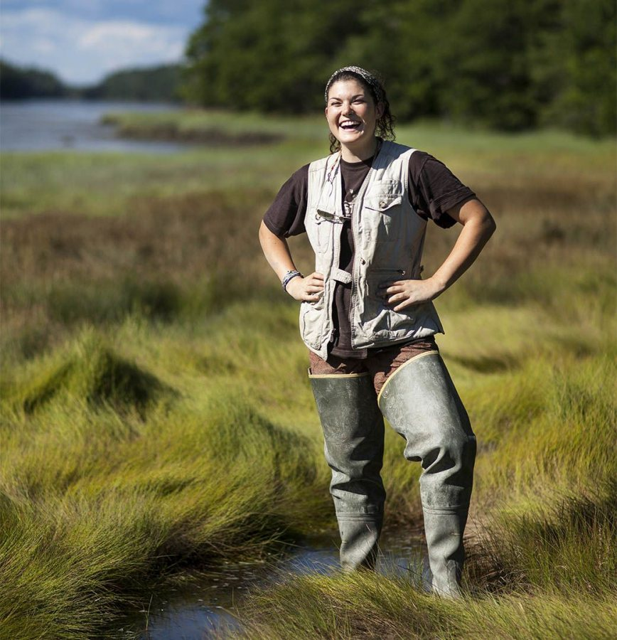 Cailene Gunn '16 of Granby, CT poses for a portrait at Long Marsh in Harpswell, ME. Gunn has been conducting field research under the supervision of Geology professor Beverly Johnson to measure methane gas and salinity levels following reclamation efforts.