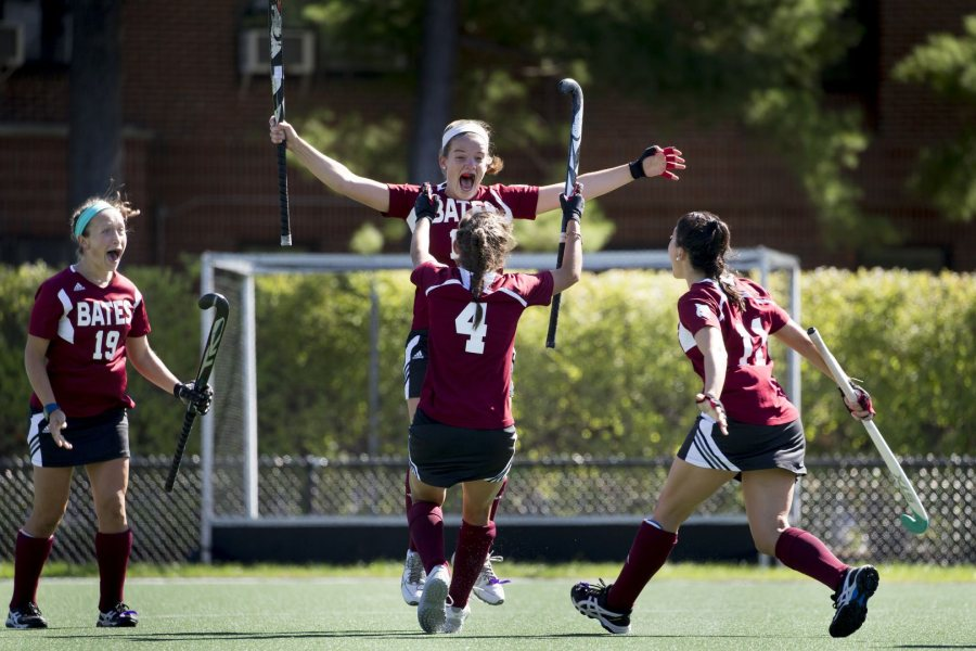 During Bates' 3-0 victory over Wesleyan, leaping Jessie Moriarty '19 of Springfield, Mass., celebrates the second of her two goals with teammate Caroline O'Reilly '18 (4) of Longmeadow, Mass. (Phyllis Graber Jensen/Bates College)