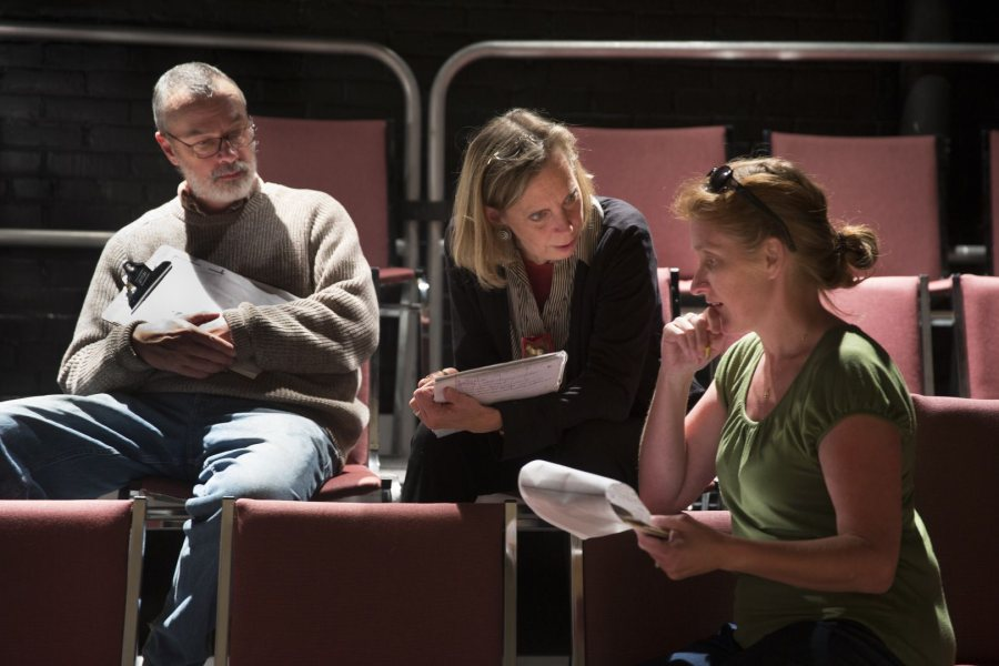 Discussing a creative point are, from left, set and lighting designer Michael Reidy, costume designer Carol Farrell, and director Sally Wood. (Phyllis Graber Jensen/Bates College)