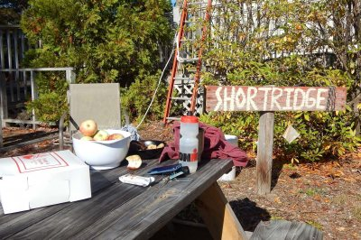 Frosty's doughnuts, apples, and Bates cookies were among the refreshments on hand for the solar installation project at Bates' Coastal Research Center at Shortridge. (Doug Hubley/Bates College)