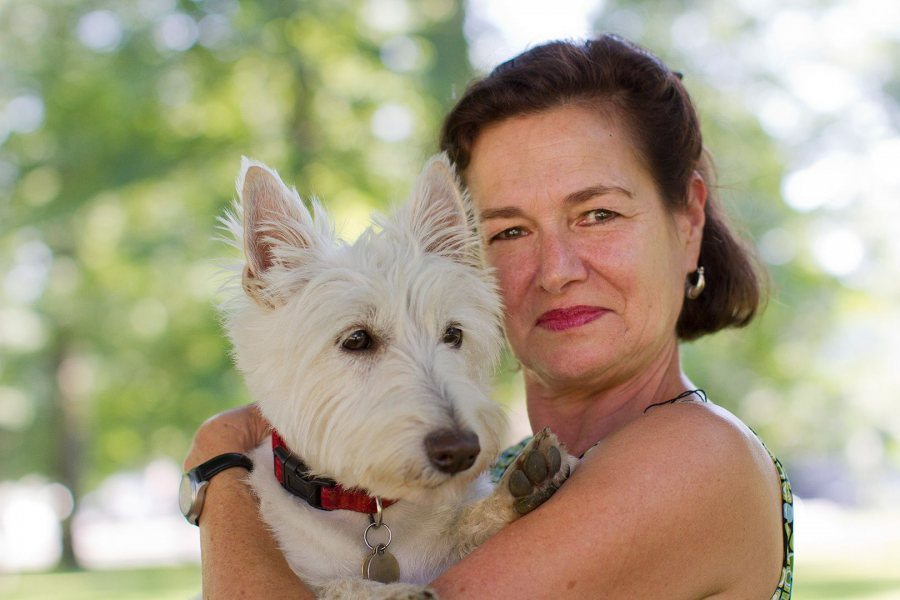 Laura Faure, director of the Bates Dance Festival, poses with Finn on the Bates campus in July 2012. (Phyllis Graber Jensen/Bates College)