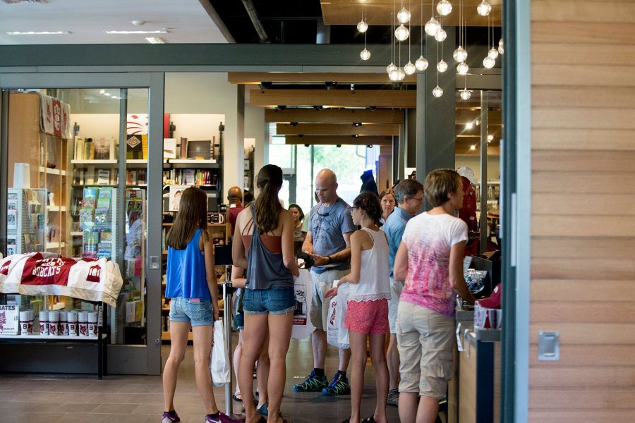 The presence of the College Store and Post & Print in Kalperis Hall brings a new density of Bates people to the south edge of campus. Here, members and families of the Class of 2020 stock up at the store in late August 2016. (Phyllis Graber Jensen/Bates College)