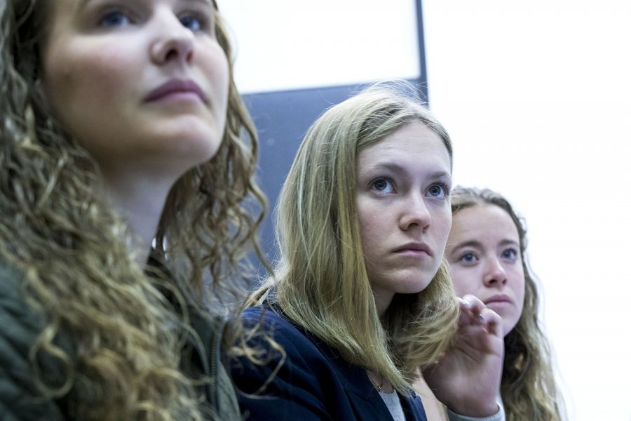 Playing the role of the GOP candidate, Molly Chisholm '17 is flanked by campaign workers Jacqueline Forney '18, left, and Honor Moshay '17 during a briefing on a public health crisis introduced into a mock presidential election in fall 2017. (Phyllis Graber Jensen/Bates College)