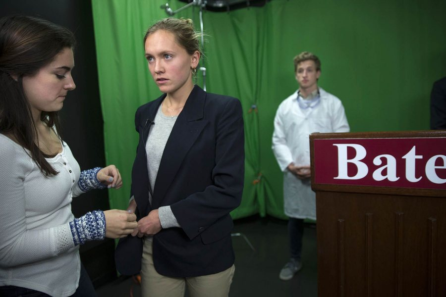 Chisholm prepares to deliver her briefing. In background, Bates EMS Sam Whitaker '18 of Hollis, N.H., gets ready to play a CDC staffer who will stand by the candidate. (Phyllis Graber Jensen/Bates College)