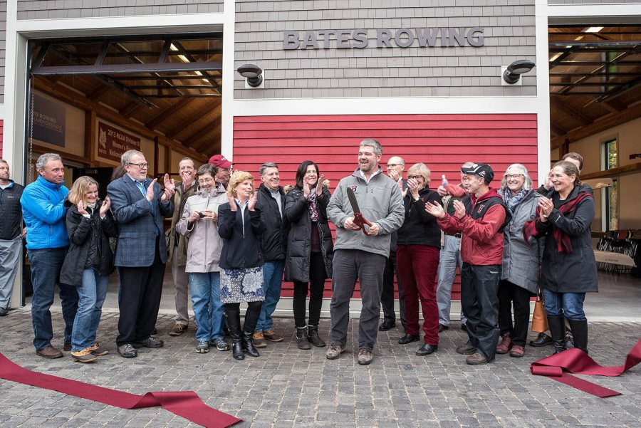 Head coach Peter Steenstra completes the ribbon cutting. (Andree Kehn for Bates College)