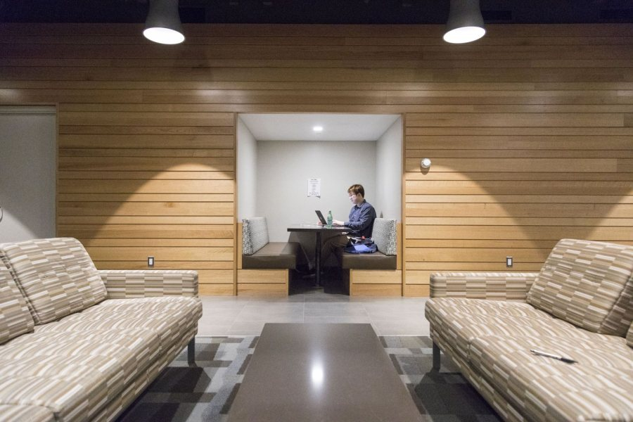 "Students like Wenkai Han '17 of Beijing, China, working on his resume in a ""niche"" in Chu Hall, are using the creatively designed spaces in Chu Hall and Kalperis Hall in equally creative ways. (Josh Kuckens/Bates College)"