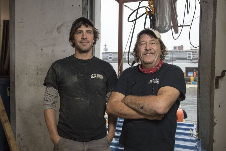 Matt Moretti '06 and his father, Gary Moretti, pose for a portrait at the Bangs Island Mussels processing facility on the Portland waterfront.
