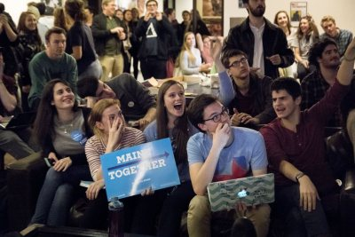 Tessa Holtzman '17 of Las Cruces, N.M., Zoe Seaman-Grant '17 of Charleston, S.C., Arianna Fano '19 of Lincolnshire, Ill., Matthew Davis '19 of Chicago, Ill., and Daniel Basuk '19 of New York City react to early east coast results. (Josh Kuckens/Bates College)