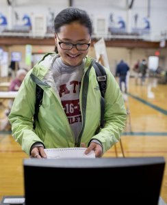 Hannah Wilson '17 of Brooklyn, N.Y., casts her ballot at the Lewiston Armory on Central Avenue, two blocks from campus, on Nov. 8. (Phyllis Graber Jensen/Bates College)