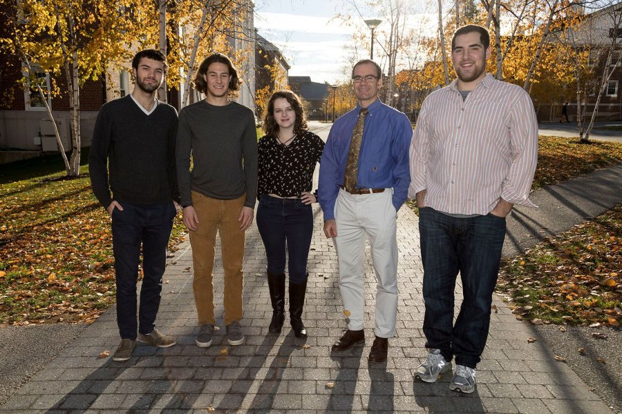 Op-ed writers Ben Aicher '18 of Falmouth, Maine, Max Milavetz '20 of Salt Lake City, Francesca Steiner '19 of Salt Lake City, Associate Professor of History Joe Hall, and Andrew Segal '17 of Glencoe, Ill., pose on Alumni Walk on Nov. 11. (Josh Kuckens/Bates College)