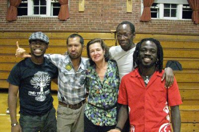 Laura Faure, center, is shown with members of the dance festival's International Artists Program in 2009 in Bates' Alumni Gym: from left, Nigerian artist Qudus Onikeku, Jose Jay B. Cruz of the Philippines, Faure, Opiyo Okach of Kenya and France, and Ivory Coast artist Michel Kouakou. (Bates Dance Festival)