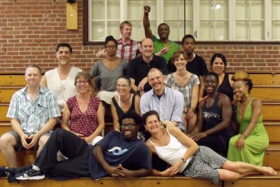 Laura Faure, front row at right, poses in Alumni Gym in July 2011 with members of the Bates Dance Festival's Young Dancers Workshop faculty. (Bates Dance Festival)