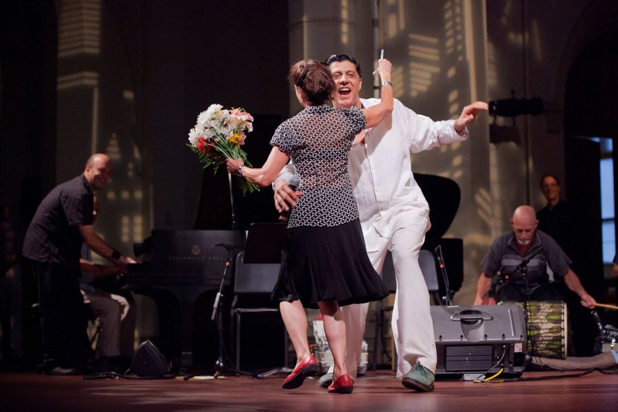 Laura Faure, Bates Dance Festival director, does a turn with musician Shamou as the festival's 2012 Musicians' Concert draws to a close at the Franco Center in Lewiston. (Phyllis Graber Jensen/Bates College)