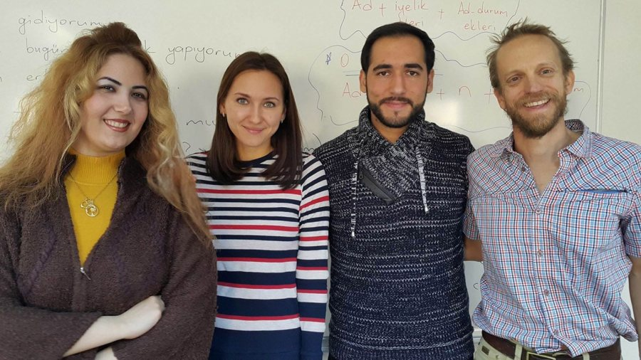 Doug Van Hoewyk '98 (right) poses with three friends, from Iran, Russia, and Syria, whom he met in his Turkish language class.