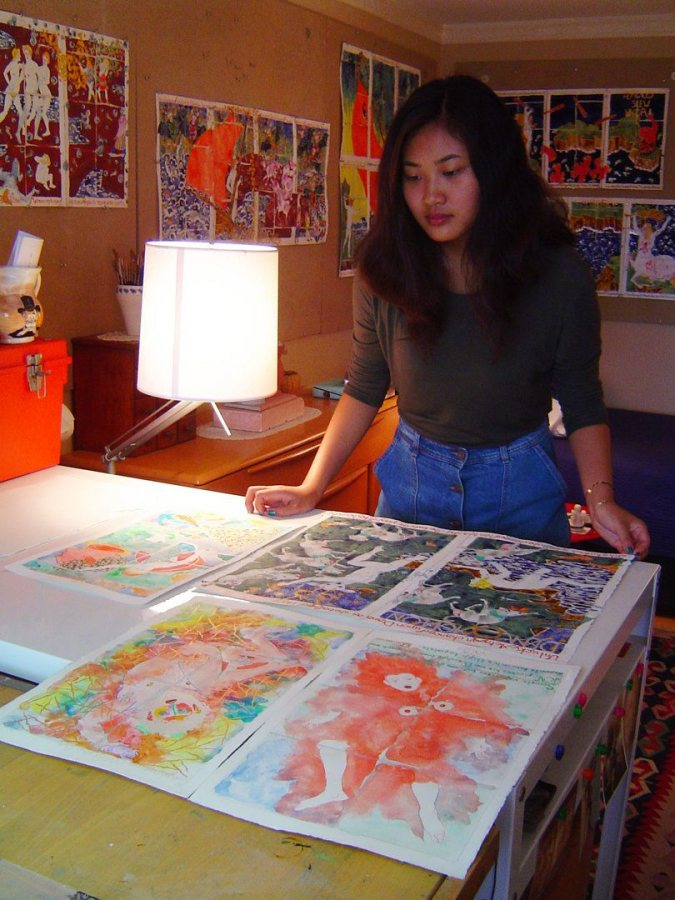 Lillie Shulman looks at watercolors by Wally Reinhardt in New York City in June 2015. (Anthony Shostak for Bates College)