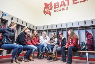 Members of the women's team gather in their new locker room. (Andree Kehn for Bates College)